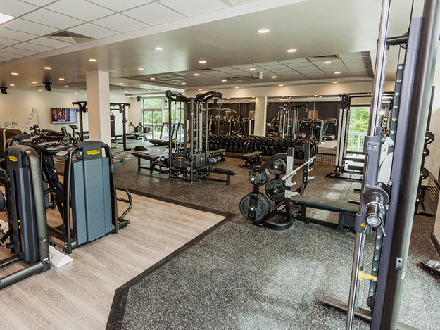 large gym with lots of fitness equipment with CV and weights